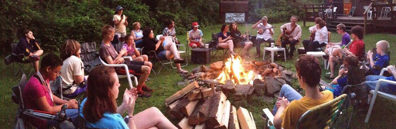 Campers and volunteers enjoy an evening of live music around the campfire at SCORE.