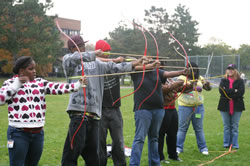 students with archery bows