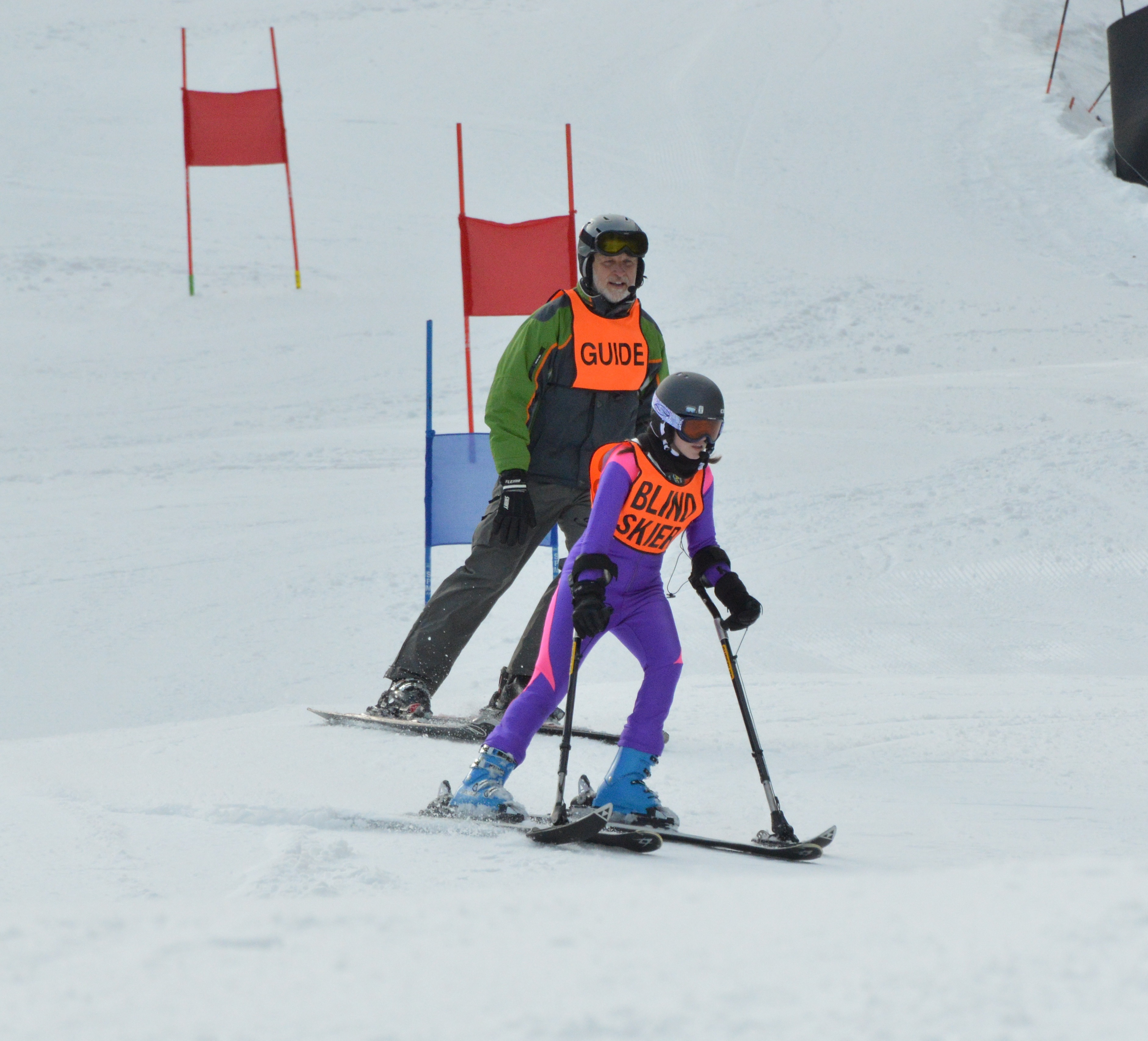 Blind ski racer and guide