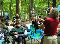 wildlife rehabilitator Richelle Ford and showing her birds of prey to students