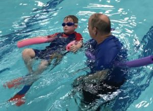 Children with special needs learn how to be safe in the water in the STRIDE swim program.
